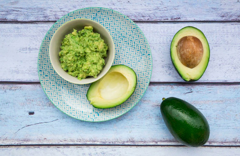 Keeping an avocado pit in guacamole will prevent it from turning brown